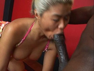 Mature asian sucks huge black cock