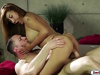 Busty asian masseuse gives costumer a bonus by riding his dick