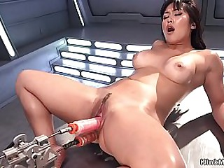 Dark haired Asian solo Milf takes fucking machine and squirting