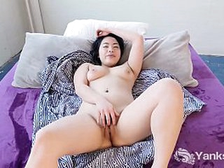 Horny asian babe from Yanks Hope Gold playing with her adorable body