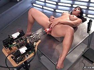 Dark haired Asian solo beauty vibrates clit and fucks machine