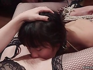 Redhead lesbian dom fists brunette Asian sub till fucks her with strap on dick