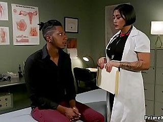 Busty brunette Asian doctor wanks off with two hands big black cock to patient